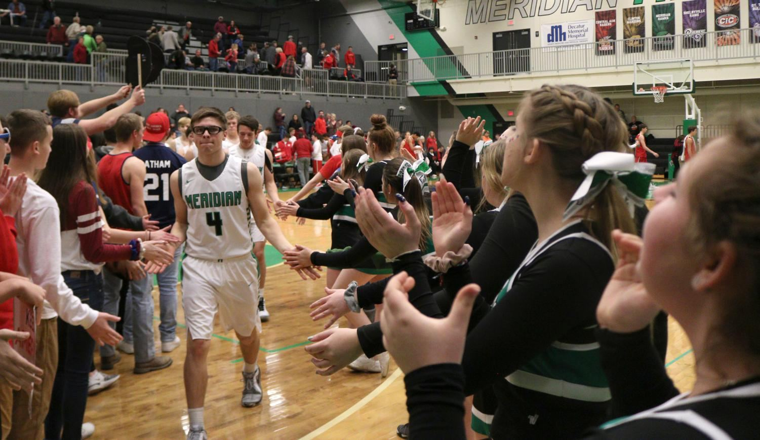 After the loss against ALAH, Meridian slapped hands with the other team in good sportsmanlike behavior.