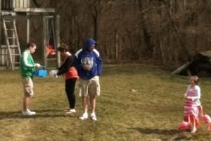 """Whitley Sapp, a junior at Meridian explores his yard with his family in their annual Easter egg hunt. Sapp does this every year for Easter. """"My grandparents and parents hides all the eggs and then we all search for them,"""" said Sapp."""