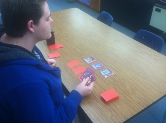 Brandan Hankal is carefully choosing what cards to play. He is playing a Japanese card game called Yu-Gi-Oh. The anime club hosted a tournament that Hankal was the winner of. Hankal said,