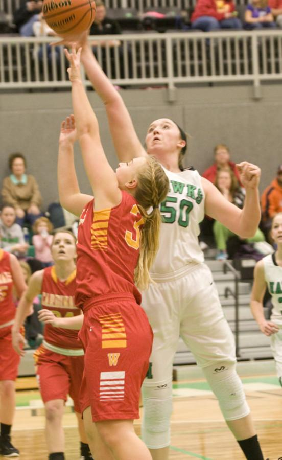 Comerford+goes+to+block+a+shot+in+the+Meridian+vs.+Warrensburg-Latham+game.