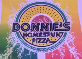 Mouth watering pizza. Donnie's pizza by Millikin University sells a variety of pizza and sandwiches for a decent price.  Donnie's has a great atmosphere for a good price on a weekend.