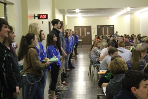 Catching Attention. The Meridian Drama Club hosts a flash mob in the cafeteria to catch the students' attention. The cast is hoping to boost their ticket sales by getting the attention of the school and community. Director, Mrs. Moore said,