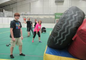 Inflatables! Who doesn't love inflatables? Beau Kallenbach was having fun racing people like, Erin Ulozas, in the obstacle course during post prom. Beau said he was feeling pain in this picture, because he had face planted the time before.
