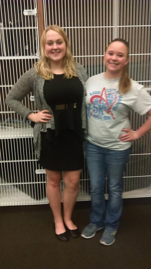 Band members stand tall together.  Senior Lauren Duffer and freshman Amy Smith stand together in front of the lockers in the new band room.  At the beginning of the year, Duffer and Smith sat next to each other, they shared music. Duffer would even help Smith when she didn't get it.