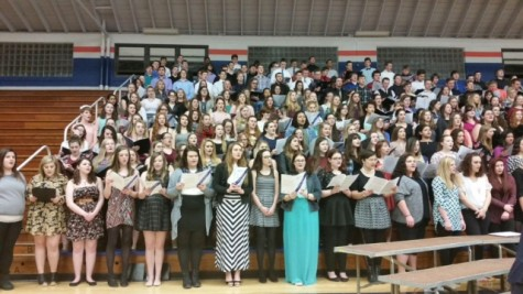 Keep singing! Students stand singing at the Macon County Choral Festival. This year was the last for the juniors and seniors to participate in. Ms. Dowd says, Keep pursuing music.  You will be able to sing for your entire life, so if you enjoy it, stick with it!