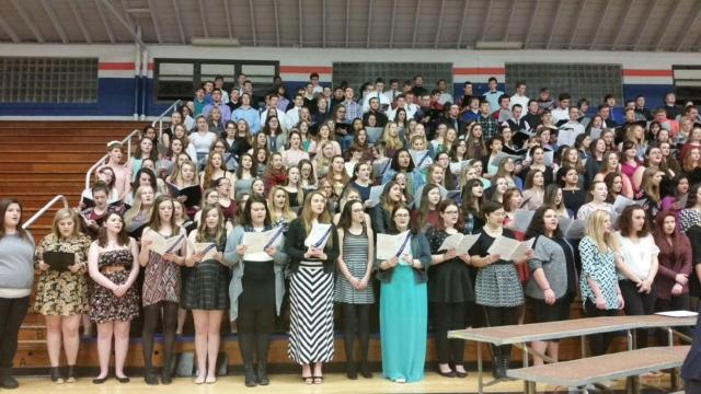 Keep singing! Students stand singing at the Macon County Choral Festival. This year was the last for the juniors and seniors to participate in. Ms. Dowd says,