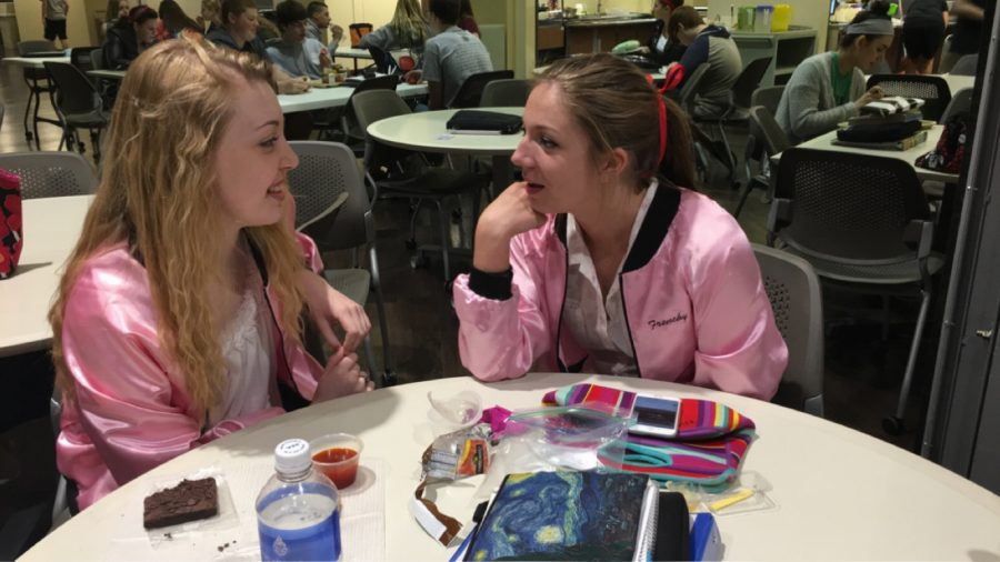 Pink lady planning. Seniors Audrey Durbin and Nikki Cromwell discuss their plans for summer vacation in