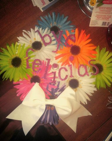 Bye Felicias! Alyssa Gentrys graduation cap shows off colorful flowers and her opinion about graduating. I got the flowers from a garage sale and everything else from Walmart and Hobby Lobby.