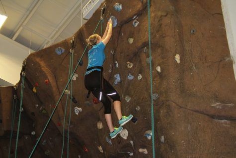 """You can do it! Prom Princess Marissa Oliver tries to make it to the top of the rock wall. Even though she didn't succeed, she enjoyed it once it was over. """"Next time-hopefully-I can get to the top rock,"""" Oliver adds."""