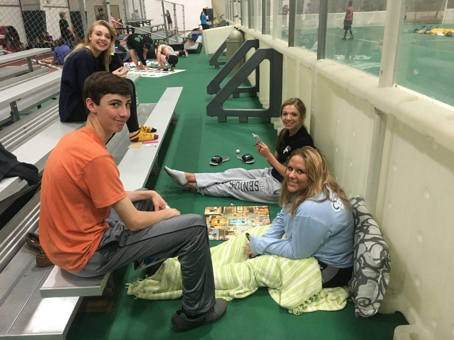 Chill. Seniors Audrey Durbin, Nicole Cromwell, Alyssa Gentry, and freshman Riley Brelsfoard relax during post prom. Post prom is a great way to hang out with friends. Its something well remember long after high school, Durbin says.