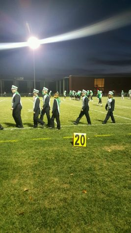 """Last time marching. Senior band members take the field to be honored for their work. This was their last time marching at a football game. """"[Music has] always been a part of me,"""" says senior Bryce Dunn."""