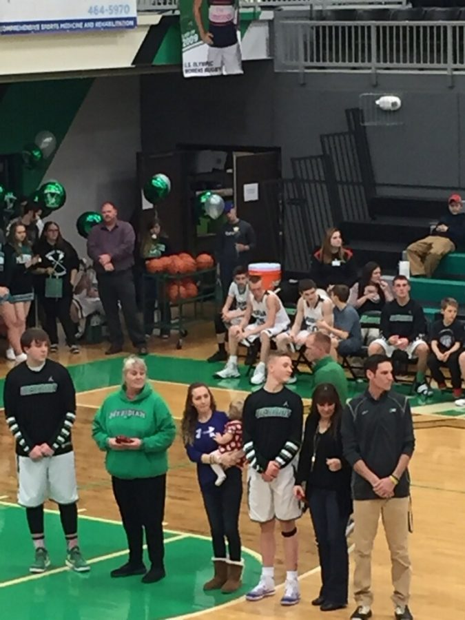 Seniors+Joe+Ford+and+Layne+Kircher+along+with+their+families+are+honored+before+the+game.+This+was+both+Kircher+and+Ford%27s+last+regular+season+home+game.+%22I+was+pretty+excited%2C+but+sad+that+it+was+one+of+my+last+games%2C%22+said+Ford.