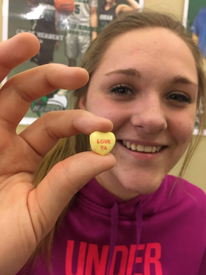 Love Ya! Keirsten Francisco holds up a candy heart. Francisco will be single this Valentine's Day.