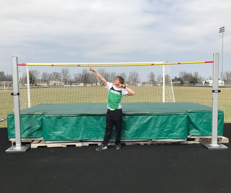 Track+star%21+Cameron+Getz+poses+in+front+of+the+high+jump+mat.+Getz+is+really+pumped+he+ended+up+accomplishing+a+new+personal+best+at+the+most+recent+meet.+Getz+stated%2C+%22It+was+a+class+1A%2C++2A%2C+and+3A+meet%2C+and+I+was+ranked+third+coming+out.+I+didn%27t+think+I+was+going+to+win+it%2C+and+was+excited+I+did+because+it+was+against+a+lot+of+big+schools.%22