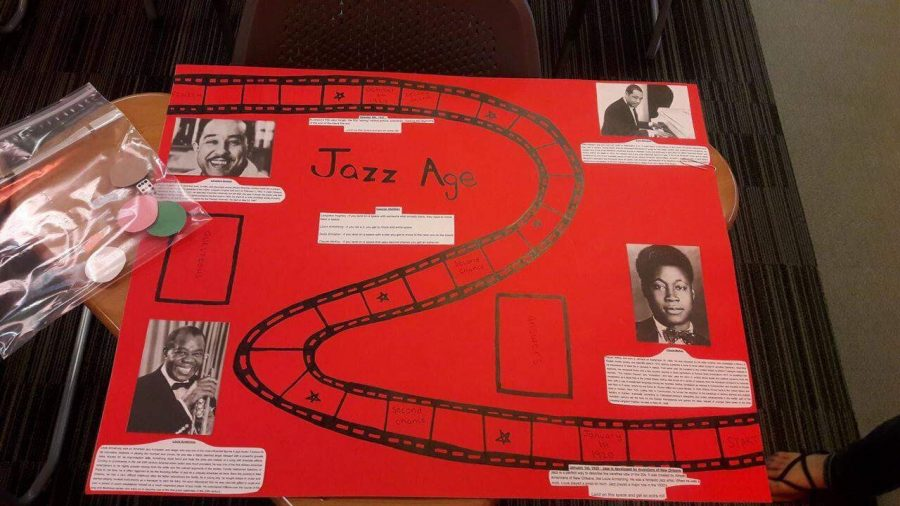 Jazzy+in+U.S.+History+class.+Students+created+their+own+board+games+with+the+1920s+incorporated+in+them.+Dylan+Reed+and+his+group+did+their+game+featuring+Jazz+Age+and+Culture.+%22My+favorite+part+about+this+was+the+game+pieces+because+I+made+them%2C%22+says+Reed.