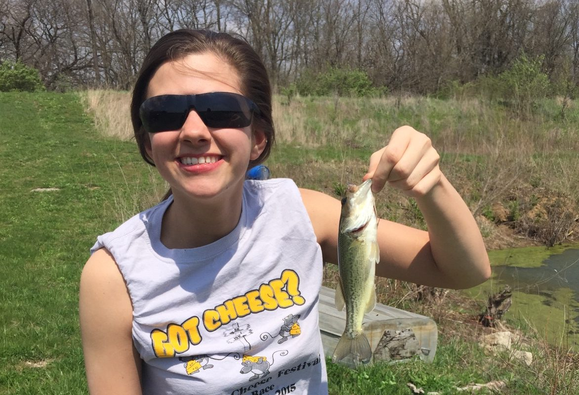 Spring fever! Emily Peterson catches a bass while fishing. Peterson states,