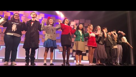 "Big fun. The cast of Heathers: The Musical gathers for bows after a successful last rehearsal before opening night. The fun show also has a serious theme to take away from it. Heather Banks (Veronica Sawyer) suggests audience members should keep the lyrics ""let us be seventeen"" in mind and ""live in the present moment and enjoy what life has in store for you."""