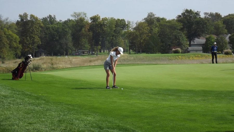 Fore%21+Grace+Miller+is+putting+for+her+par+during+her+state+match.+Miller+placed+36th+in+state+this+year.+%22I+have+been+playing+golf+since+I+was+five+years+old%2C%22+says+Miller.