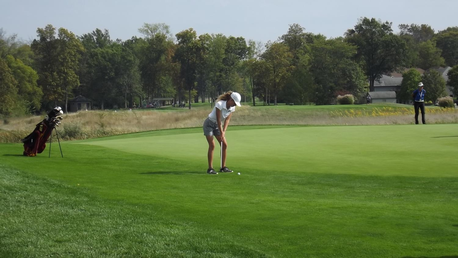 Fore! Grace Miller is putting for her par during her state match. Miller placed 36th in state this year.
