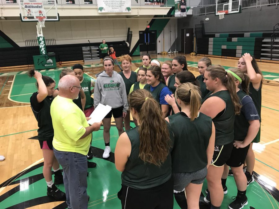 %22Team%22+on+three%21+As+the+girls+basketball+team+huddles+up%2C+Mitch+Cloe%2C+the+head+coach%2C+discusses+the+team+expectations+and+goals+of+the+larger+team+for+this+upcoming+season.+Compared+to+last+year%27s+numbers%2C+this+year+there+was+an+increase+in+girls+basketball+players.++Cloe+said%2C+%E2%80%9CWe+had+13+players+last+year.+We+are+going+to+be+around+18+this+year.+This+year+will+bring+depth.%E2%80%9D