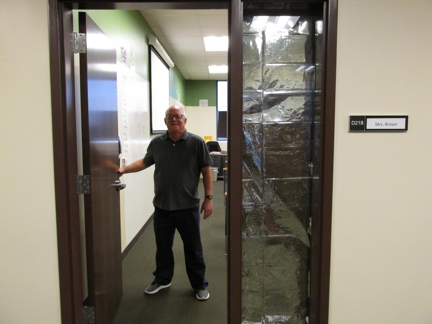 Mr. Markus holds the door for students excited to get to work in his class.