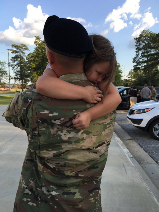 The+feeling+of+a+hug+after+missing+a+loved+one+is+almost+unexplainable.+Whether+it+be+after+basic+training%2C+or+any+amount+of+time+away+from+home%2C+the+hug+from+a+soldier+is+usually+the+first+exchange+to+show+the+happiness+of+being+back+with+their+families.+%22Our+little+princess+%5BHickman%27s+niece%5D+misses+her+hero%2C%22+says+Becky+Walters.