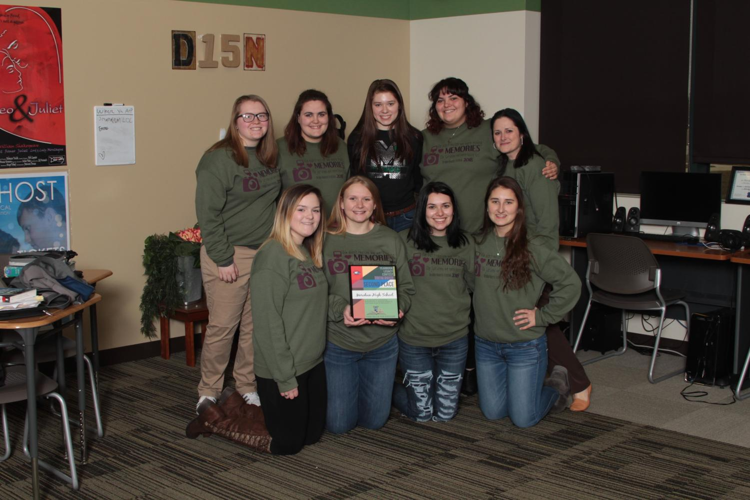 Meridian Moments accepts their second place award from Inter-state Studios. The yearbook staff competed against thousands of high schools nationwide. Marissa Oliver said,