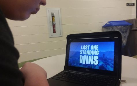 Watching film. Freshman Jordan GoodmanStreet watches one of the trailers for the game. GoodmanSteet had played only once before.
