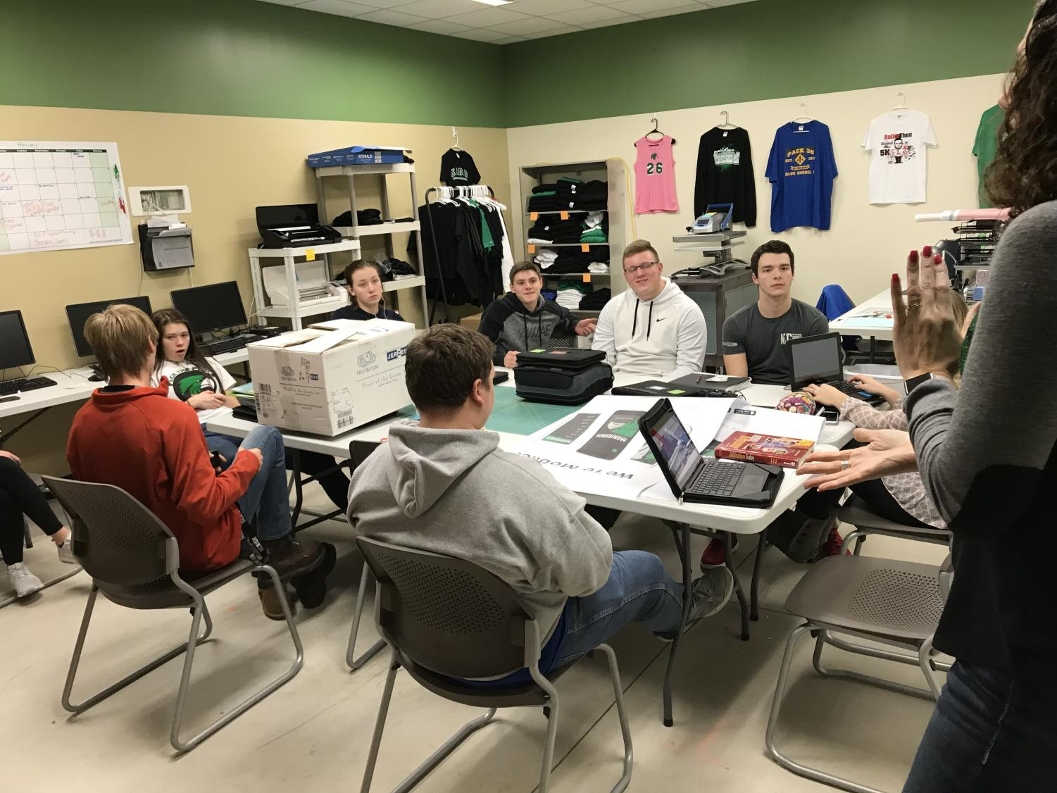 The entrepreneurship class plans to attend the DAX trade show at Tinley Park, IL. The students thought it'd be a great idea to put the extra money they make from shirt sales to use.