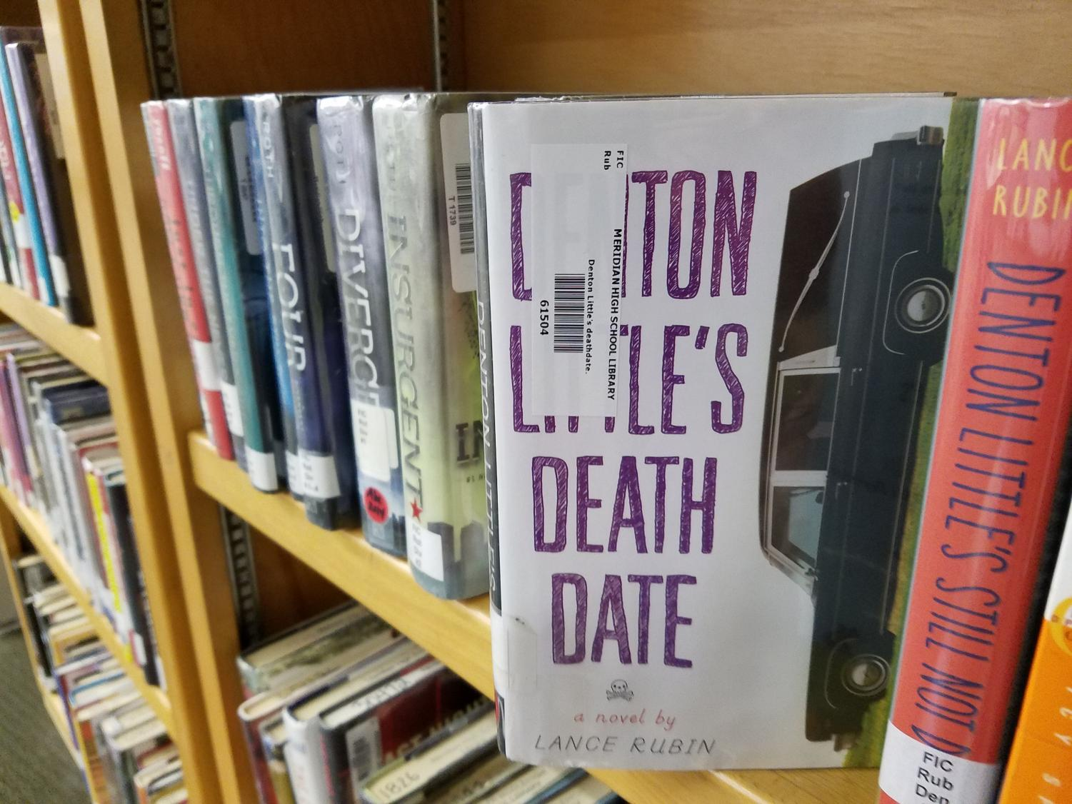Available. Denton Little's Death Date is sitting at the MHS library ready to be checked out.