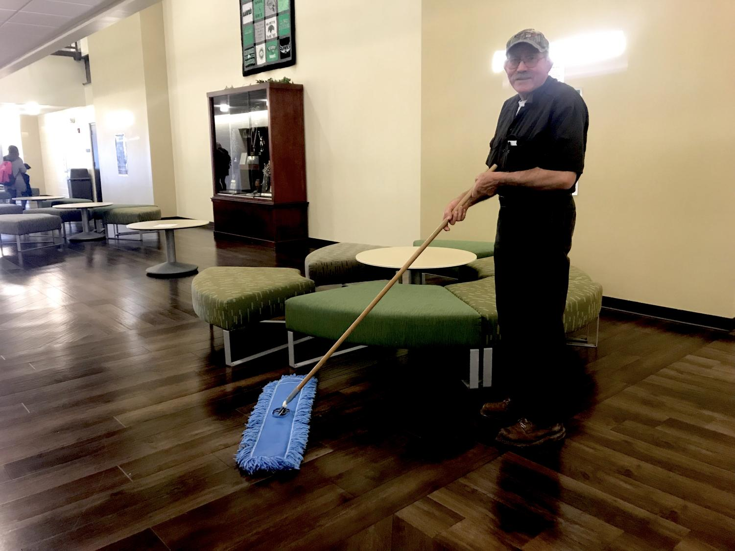 Doug Powers sweeps the great hall as one of Meridian's custodians after working the morning at his farm. Powers started working at Meridian seven years ago, and he has impacted a great amount of people throughout those years. Power's daughter, Victoria McDonald, said,