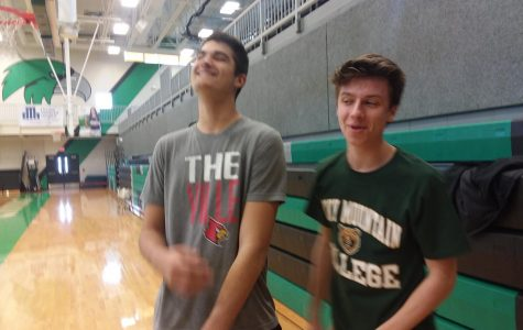 Crack up! Seniors Connor Hurelbrink and Gabe Taylor share a laugh during study hall. The two have already been accepted to the colleges they sport on their shirts.