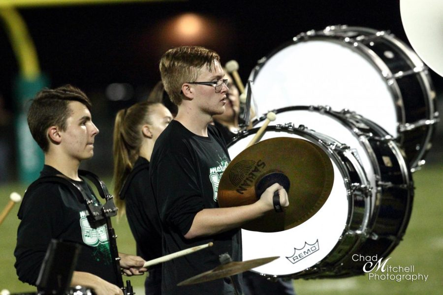Meridian High Schools drum line is headed by Brian Reed, junior. The drum line is the basis for many cheers, keeps the band on beat, and leads the band on and off the field. Marching band has taught me to follow directions and to work until you cant work anymore, then work some more. I feel it has in ways prepared me for the future, said Reed.