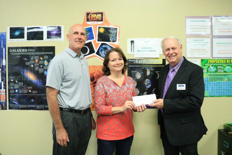 Sheila Rappe received her grant check from Jim Barr on September 18, 2018. She shared how the grant will impact her students, I think the lab activities will give the students a more accurate picture of concepts such as genetic recombination and polygenic inheritance. In addition, any time students can actively discuss what they are experiencing through a lab, more learning takes place.