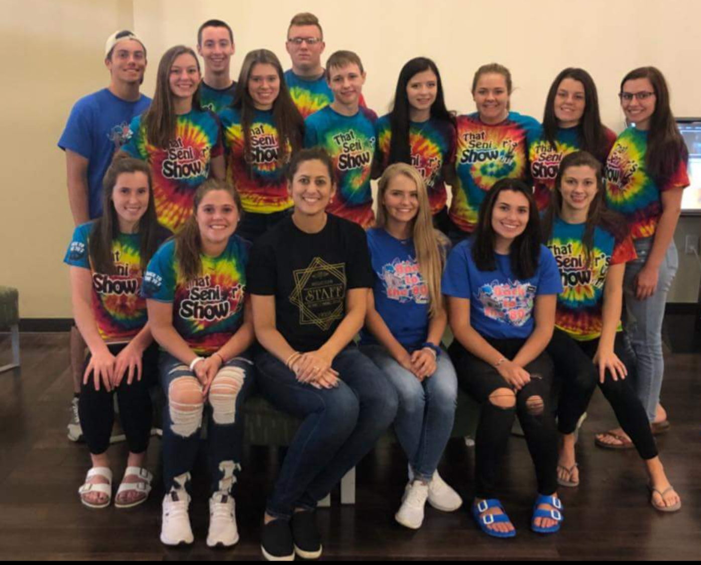 Entrepreneurship class posses for picture in their homecoming shirts which they made for students at Meridian High School.