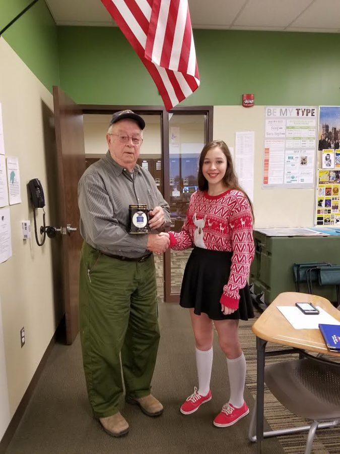 Proud.  Sadie Scott shakes the hand of Richard Hilvety in 2016 during the making of a Veterans Day video produced by the journalism class. The administration played the video in the hallways during the week of Veteran's Day that year.