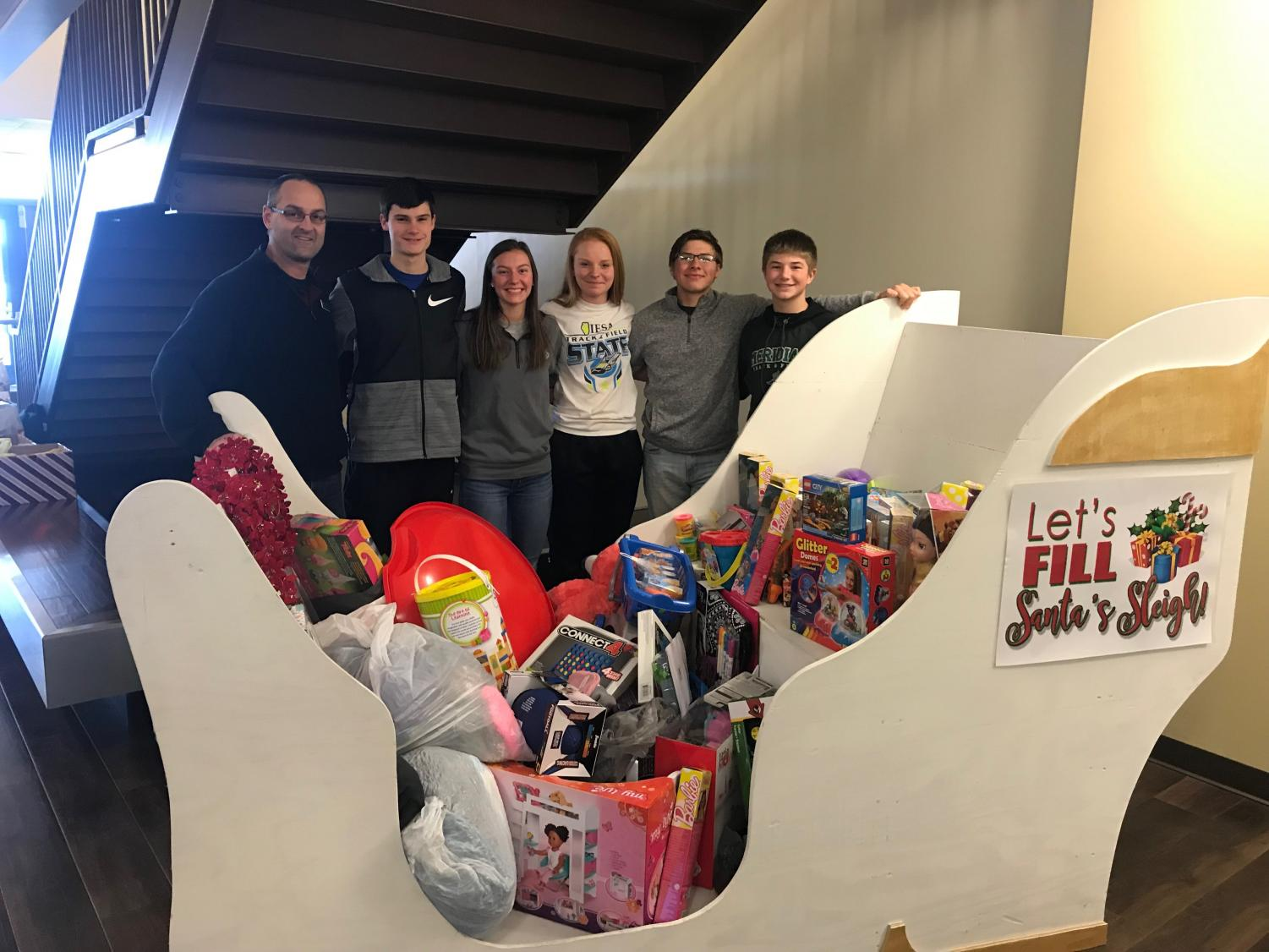 Let's fill Santa's sleigh. Kyle Karsten, Drew Hurelbrink, Erin Fasick, Abbi Hackert, Cristian Scott, and Lucas Clapp carried out the collected toys from the school. The toys were then taken to the Salvation Army gymnasium on December 8, 2018.