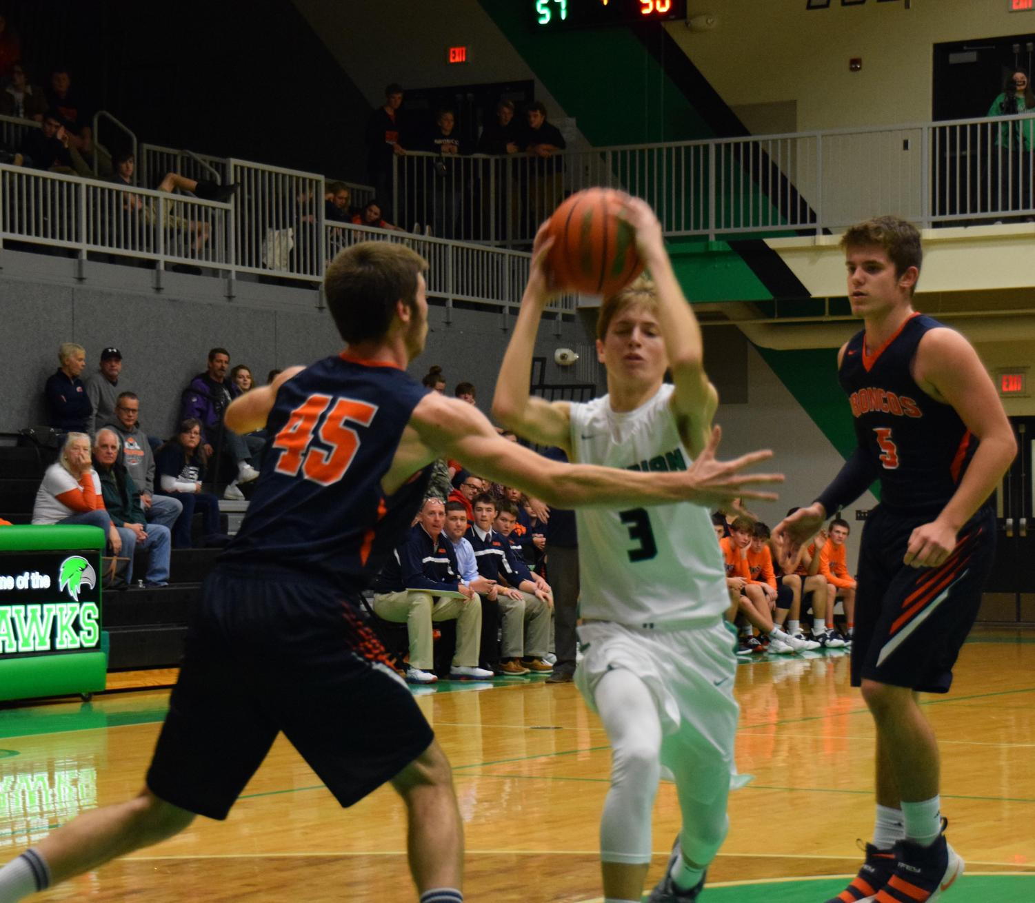 ALL THE WAY! Garrett Meisenhelter takes it to the hole for the Hawks against the Broncos in the varsity game on Tuesday, December 11. The Hawks went on to narrowly beat Cerro Gordo 66-61.