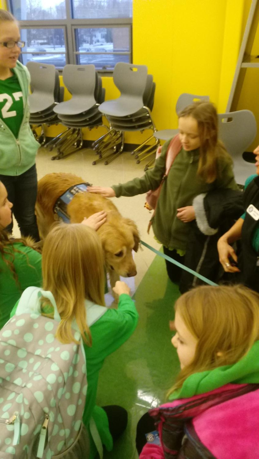 Students at the elementary school took full advantage of the comfort dogs brought in by Pawprint Ministries.