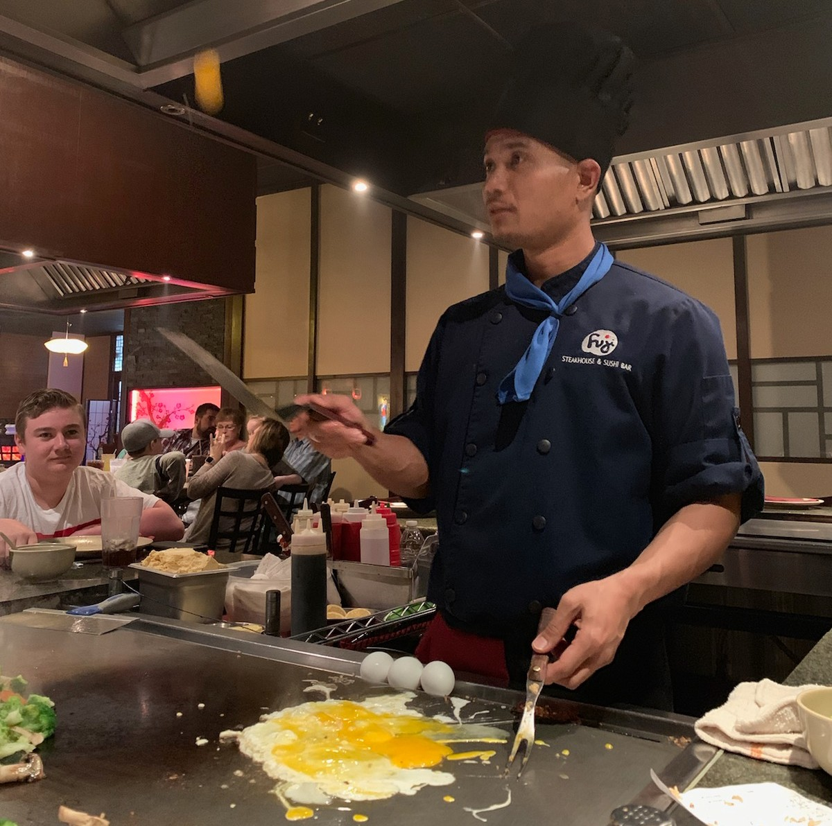 The chefs at the Hibachi grill are trained to entertain you via doing tricks such as throwing food and catching it and twirling their utensils.