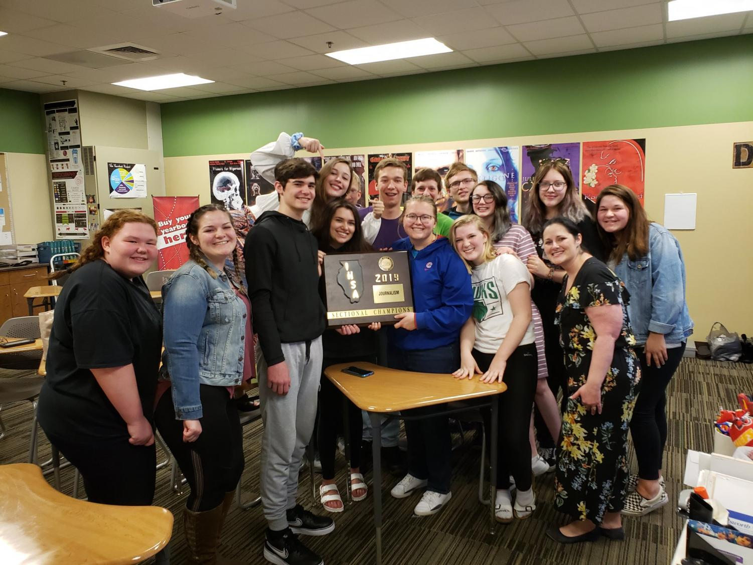 The Meridian Journalism Sectionals Team is presented with their Sectionals Champions plaque after thinking they truly got second for a couple of weeks.