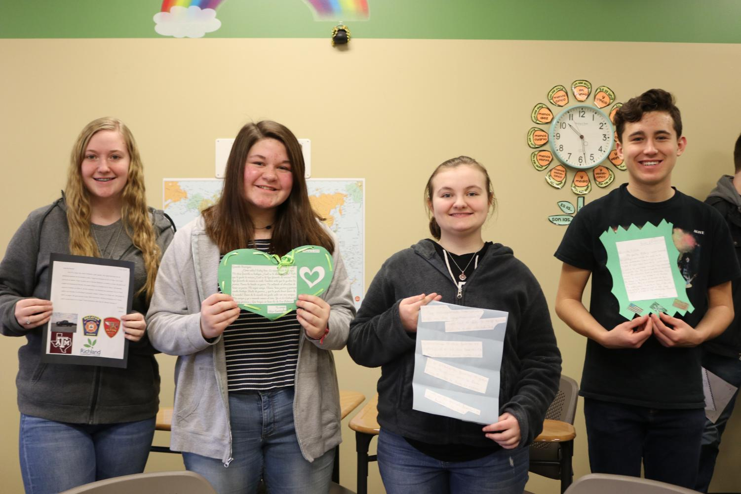 Spanish II students  (Hannah Gillespie, Karrigan True, Caiden Scott, and Gideon Hill) hold their pen pal letters.