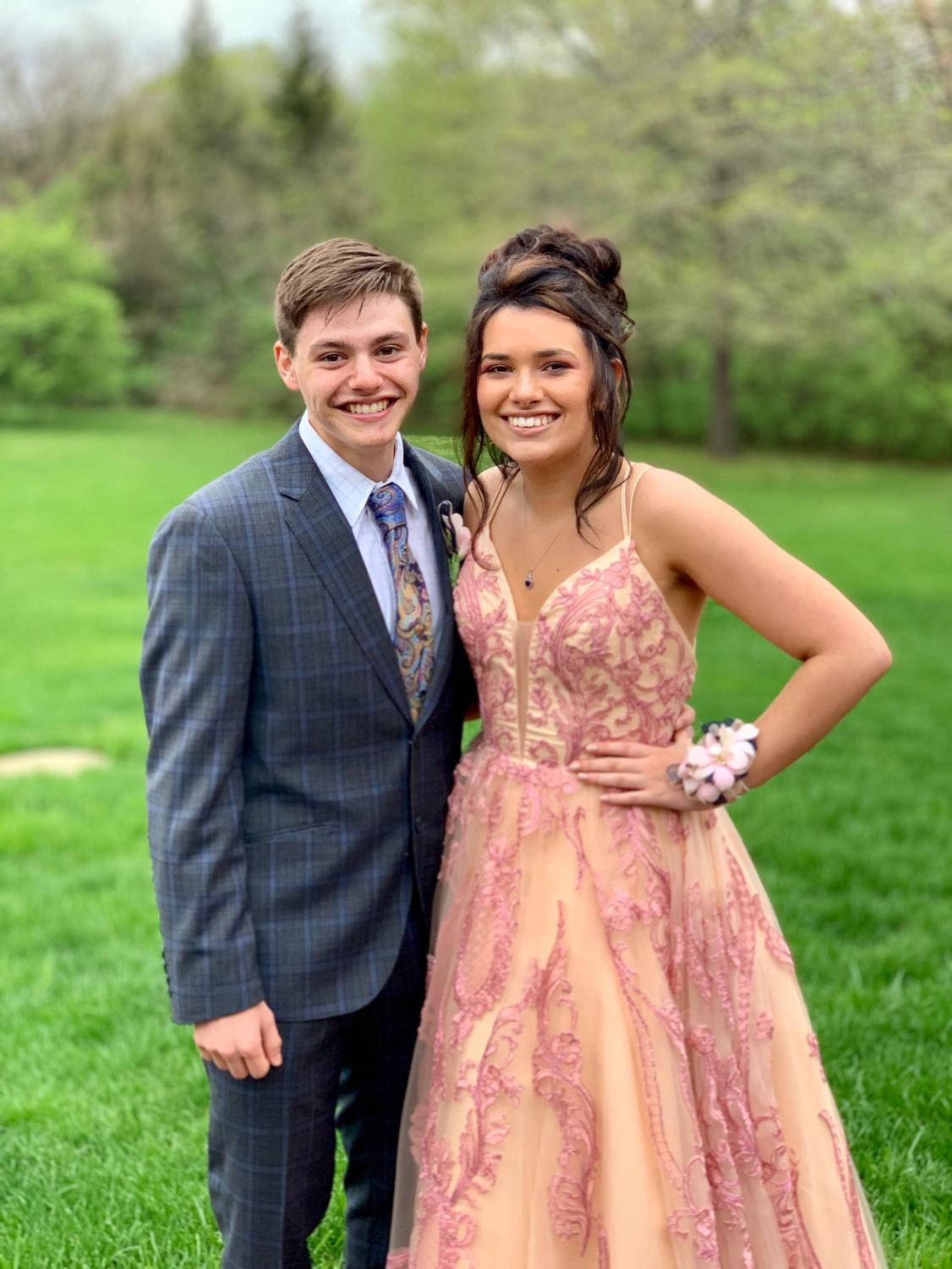 Happy 25th prom night, Meridian! Evan Dawson, senior, and his date, Claire Palmer, junior, show off their final look. A few days before, Dawson was informed of being included on prom court, so they had to make sure to look flawless.