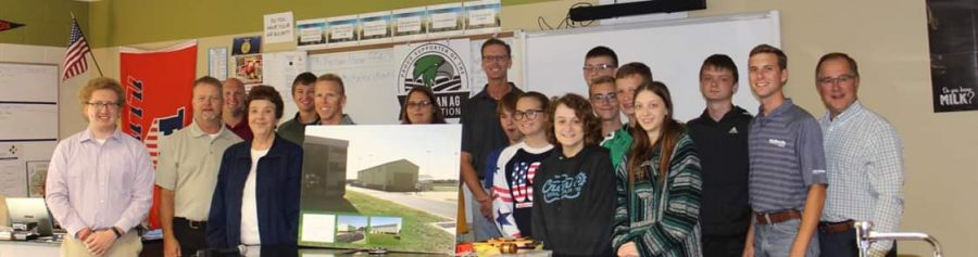 Roberta Gorden with members of the Meridian AgTech Foundation and Jerry Brockett's Intro to Ag class by artist's rendering.