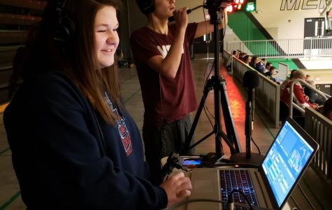 Journalism students Karrigan True and Tyler Ward live stream a basketball game.