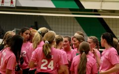 Meridian Volleyball in a timeout during their pink night game against Warrensburg-Latham.