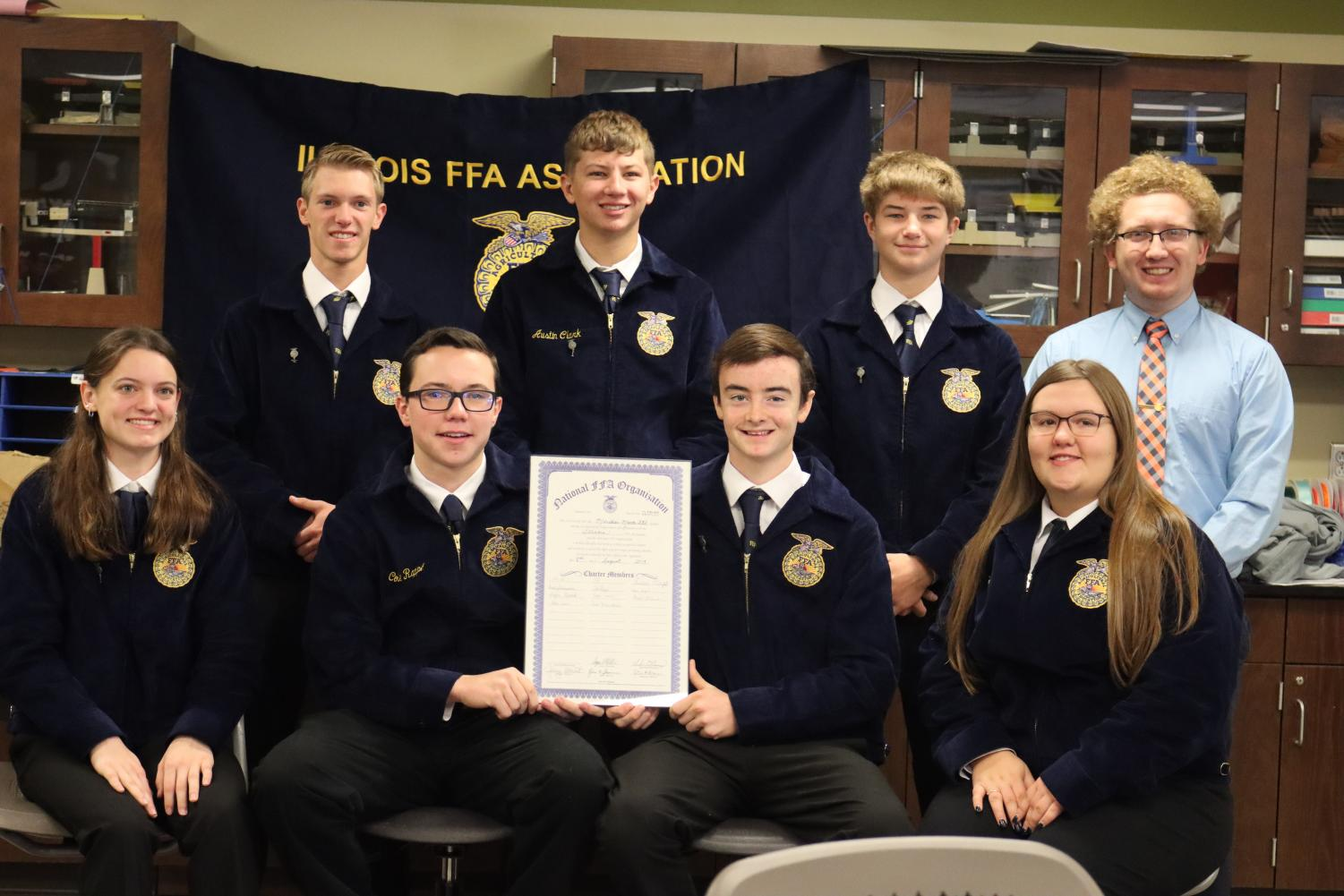 Meridian FFA chapter poses with their charter.