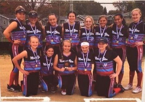 Emmy+Renfro+poses+with+her+travel+softball+team+at+a+tournament.+%22I+enjoy+them+because+it%27s+a+fun+way+to+have+a+good+time+with+my+teammates+while+playing+softball%2C%22+said+Renfro.