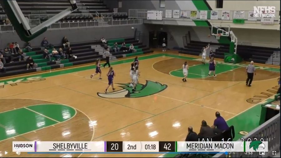 Riley Olinger (32) steals the ball and scores two late in the game. Meridian junior varsity would win this match-up with Shelbyville on Jan. 16.