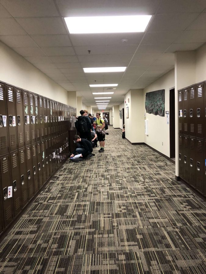 Freshman students in their hallway, packing up to leave school at the end of the day.